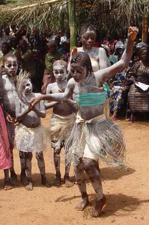 Music of Sierra Leone - Students celebrate with traditional dancing in Koindu, Kailahun District, Sierra Leone