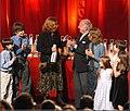 Silvia Bleichmar recibiendo el Konex de Platino 2006 con los nietos.jpg