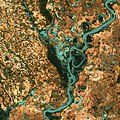 Small, blocky shapes of towns, fields, and pastures surround the graceful swirls and whorls of the Mississippi River. Original from NASA. Digitally enhanced by rawpixel.jpg