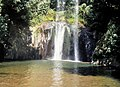 Small bathing lake formed by the Castel Giuliano waterfall, Lazio, Italy.jpg
