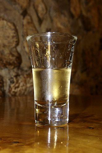 Pálinka - A glass of Hungarian apricot pálinka.
