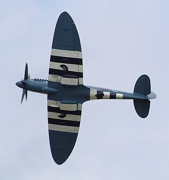 Supermarine Spitfire - The elliptical planform of a Spitfire PR.Mk.XIX displayed at an air show in 2008. The black and white Invasion stripes are visible.