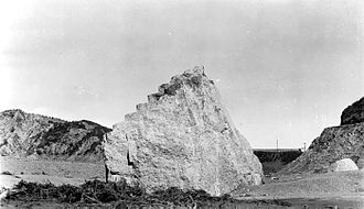 St. Francis Dam - Concrete block from the west abutment of the dam about half a mile below the dam site. Approximately 63 ft. long, 30 ft. high and 54 ft. wide. The wing wall is in the distance.