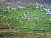The Village. The Head Wall surrounds the site, with Tobar Childa top left, the 19th century Street at centre and the new military base to the right.