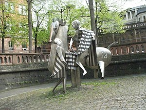 Roman Catholic Diocese of Mainz - Modern stainless steel sculpture of St. Martin in front of the Martinus School Mainz in the old town of Mainz