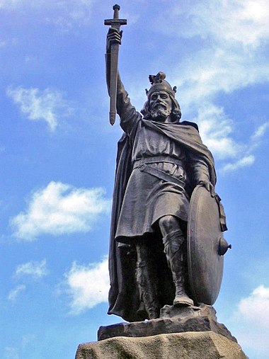 Alfred the Great statue in Winchester, Hampshire. The 9th-century English King proposed that primary education be taught in English, with those wishing to advance to holy orders to continue their studies in Latin. Statue d'Alfred le Grand a Winchester.jpg