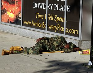 English: A man sleeping on the street of The B...