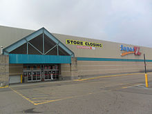 Kmart wikipedia a super kmart center store with super kmart signage in southgate michigan in july 2014 as indicated through the banner this store began a liquidation gumiabroncs Gallery
