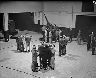 1st Anti-Aircraft Division (United Kingdom) - Men of a TA battery training on a 3-inch gun at their drill hall in 1938.