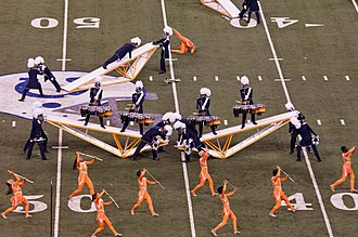 Bluecoats Drum and Bugle Corps - Bluecoats tenor drum players and guard perform at the 2014 DCI World Championship Finals in Indianapolis, Indiana.