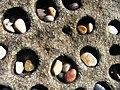 Tafoni and pebbles at Pebble Beach, San Mateo County, California.jpg