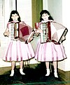 Terrie and Jennie Frankel 8 years old Accordions and Pink Dresses.jpg