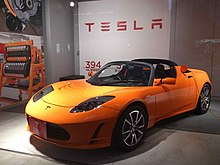 Roadster Charging In A Anese Showroom