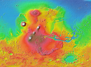 Volcanology of Mars - MOLA colorized shaded-relief map of western hemisphere of Mars showing Tharsis bulge (shades of red and brown). Tall volcanoes appear white.