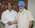The Chief Minister of Nagaland, Shri Neiphiu Rio meeting the Deputy Chairman, Planning Commission, Shri Montek Singh Ahluwalia for finalizing plan size for 2012-13 for the State, in New Delhi on June 26, 2012.jpg
