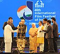 The Minister of State for Information & Broadcasting, Col. Rajyavardhan Singh Rathore lighting the lamp at the inauguration of the 46th International Film Festival of India (IFFI-2015), in Panaji.jpg