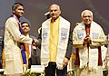 The President, Shri Ram Nath Kovind presenting the Gold Medal to a student, at the 7th Convocation of Babasaheb Ambedkar University, at Lucknow, in Uttar Pradesh (1).jpg
