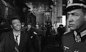 The Train (1964 film) - L. to R.: Paul Scofield, Michel Simon (background) and Burt Lancaster in The Train