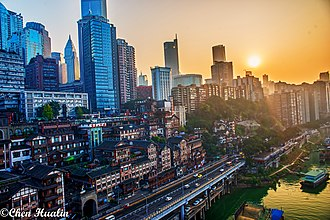 Chongqing - The skyscrapers of Chongqing CBD with Hongya Cave at sunset