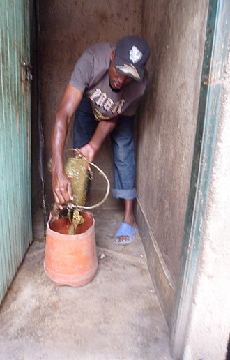 "Manual scavenging - Example for unsafe manual pit emptying (which could be termed ""manual scavenging"") of a pit latrine in Korogocho slums in Kenya"