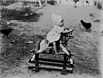 Toddler on a rocking horse (3198305722).jpg