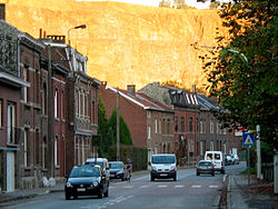 Trooz: main street, with the cliffs behind illuminated by the setting sun