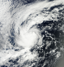 A visible satellite image depicting a small tropical storm well away from land on October 8.