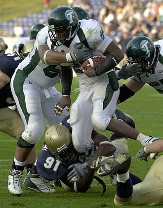 Mewelde Moore - Moore rushing for Tulane