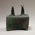 Two cats surmounting a box for an animal mummy MET 04.2.601 EGDP014446.jpg