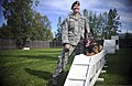U.S. Air Force Staff Sgt. Stacy Glass, assigned to the 673rd Air Base Wing, 673rd Security Forces Squadron, poses with Chase, her military working dog, during a training session at Joint Base 130826-F-LX370-657.jpg
