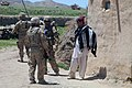 U.S. Army Capt. Alex A. Kaivan, center right, the commander of Baker Company, 1st Battalion, 506th Infantry Regiment, 4th Brigade Combat Team, 101st Airborne Division, speaks with a resident in Paktia province 130529-A-CW939-127.jpg