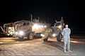 U.S. Army Spc. Sean Miller, a combat engineer, with Alpha Company, 1st Brigade Special Troops Battalion, 1st Brigade, 82nd Airborne Division (Advise and Assist Brigade), stands in front of vehicles, used 100323-A-DK678-001.jpg
