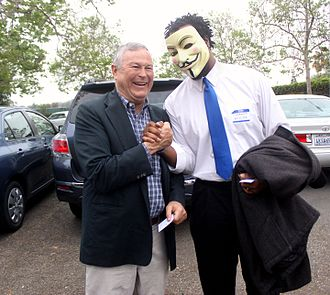 Dana Rohrabacher - Rohrabacher shakes hands with a supporter wearing a Guy Fawkes mask in 2013