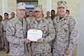 U.S. Marine Corps Gen. James F. Amos, left, the commandant of the Marine Corps, and Sgt. Maj. of the Marine Corps Micheal P. Barrett, right, participate in an awards presentation with Marines and Sailors 130616-M-LU710-021.jpg