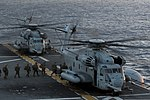 U.S. Marines assigned to the 31st Marine Expeditionary Unit (MEU) board a CH-53 Super Stallion helicopter attached to Marine Medium Tiltrotor Squadron (VMM) 265 on the flight deck of the amphibious assault ship 140310-N-LM312-034.jpg