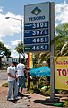 "U.S. Marines post signs at the Tesoro gas station on Palama Street as they volunteer during the 6th Annual Special Olympics Hawaii fundraiser called ""Fueling Dreams"" in Honolulu, Hawaii, July 1, 2011 110701-M-TH981-004.jpg"