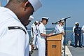 U.S. Navy Chief Logistics Specialist Rommel Langomez, at the lectern, gives a benediction aboard the guided missile destroyer USS Ross (DDG 71) in the Black Sea during a 9-11 remembrance ceremony Sept 140911-N-IY142-029.jpg