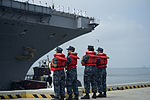U.S. Sailors watch as the aircraft carrier USS Harry S. Truman (CVN 75) departs Naval Station Norfolk, Va., July 22, 2013 120722-N-BD629-038.jpg