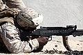 U. S. Marine Gunnery Sgt. William Curry with Engineer Company, Combat Logistics Regiment 2, 2nd Marine Logistics Group, fires a M240B at the crew serve weapon skills training during Enhanced Mojave Viper (EMV) 120902-M-KS710-034.jpg