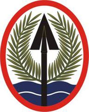Multi-National Corps – Iraq - The Shoulder Sleeve Insignia (SSI) of Multi-National Corps – Iraq (MNC-I).