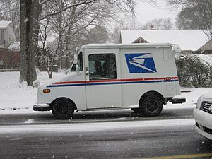 USPS truck delivering mail in the snow. Photo ...