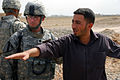 US Army 52959 TAJI, Iraq- Ozark, Ala. native, Lt. Col. Eric Schwegler (left), commander of the 1st Battalion, 82nd Field Artillery Regiment, 1st Brigade Combat Team, 1st Cavalry Division, listens as the Odessa Brid.jpg