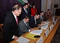 US Navy 021024-N-5329L-001 John Herbst, U.S. Ambassador to Uzbekistan, and Hakim Alisher A. Atabaev, Mayor of the Fergana region, sign the official turnover documents between the republic of Uzbekistan and the United States.jpg