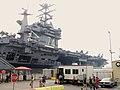 US Navy 031029-N-0085B-001 USS John C. Stennis (CVN 74) is moored pier side under a cloud of ash and haze at Naval Air Station North Island.jpg