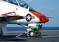 US Navy 040918-N-3986D-008 Airman Marlon Bradly of Macon, Ga., makes final checks to a T-45A Goshawk attached to Training Air Wing One (TW-1).jpg