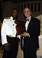 US Navy 041015-N-4658M-108 Commander, Naval Forces Marinas, Rear Adm. Arthur Johnson, presents Secretary of the Navy (SECNAV) Gordon England, with a Latte Stone at the 229th Navy Ball held in Tumon, Guam.jpg