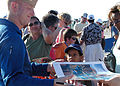 US Navy 041107-N-8683B-110 Lt. Cmdr. John Saccomando, assigned to the U.S. Navy flight demonstration team, the Blue Angels, signs autographs after their performance.jpg