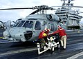 US Navy 041113-N-6817C-151 Aviation Ordnancemen load a AGM-114 Hellfire missile onto an HH-60H Seahawk.jpg
