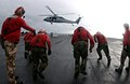US Navy 050210-N-0905V-065 Sailors assigned to the Weapons Department, G-1 Division, aboard USS Carl Vinson (CVN 70), sprint to retrieve weapons during a vertical replenishment.jpg