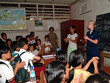 US Navy 050427-N-0357S-010 With help from an interpreter, Hospital Corpsman 2nd Class Cyrena Williams teaches a class on infectious disease to students at a school on the island of Nias, Indonesia.jpg